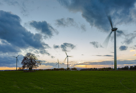 Wind turbine wind wind energy wind power wheels field sunset sky clouds dusk blurred photo