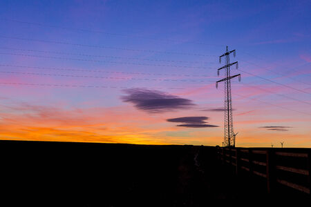 Sunrise electricity pylon energy winter silhouette nature orange blue hour hot sunlight photo