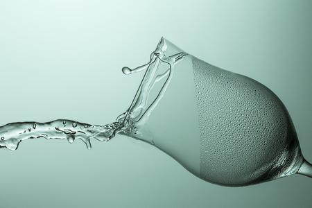 Wine glass of water splash rinse hygienic glass splatter dew drop shod cool drinking water photo
