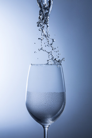 Wine glass of water splash rinse hygienic glass splatter dew drop shod cool drinking water photo