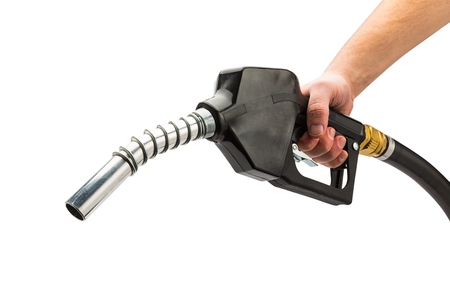 refuel: hand holds a black fuel pump nozzle isolated on white background Stock Photo