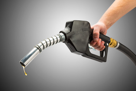 holding a gas pump nozzle