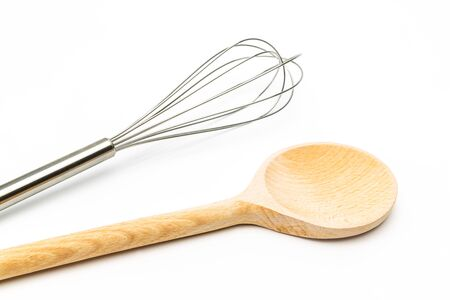 wooden spoon: whisk with wooden spoon on white background