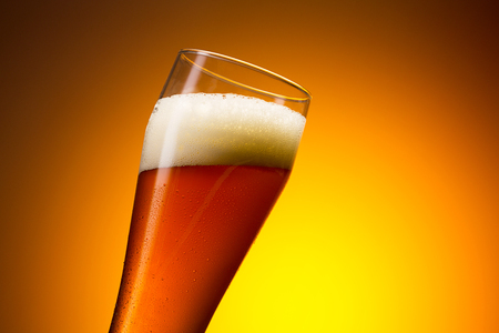 beer garden: cold glass of wheat beer Stock Photo