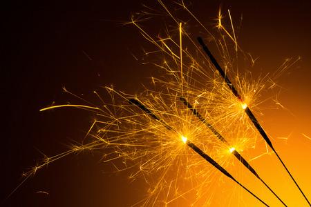glow pyrotechnics: sparklers burned on orange background