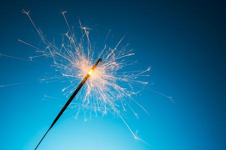 A sparkler on blue background.