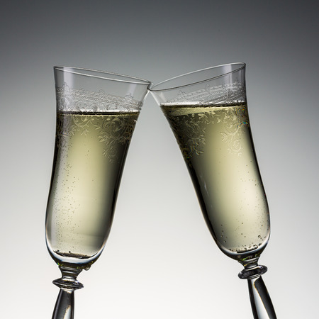 clink: clink champagne glasses.   Stock Photo