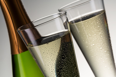 christmas profits: Cold champagne with water drops an bottle.   Stock Photo