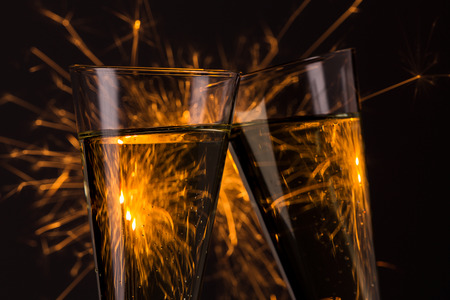 clink: clink glasses with fireworks background on new year\
