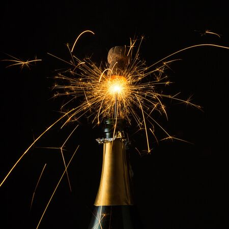 popping cork: bottle of champagne with sparkling popping cork