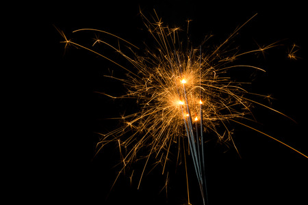 ignited: group of fireworks Ignited Sparklers on black background Stock Photo