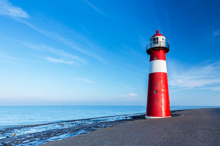 lighthouse a the Netherlands coast in westkapelle 스톡 콘텐츠