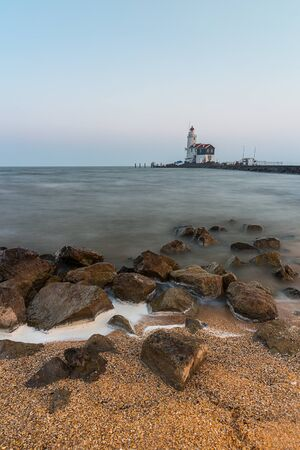 north holland: lighthouse on sea in marken in holland Stock Photo