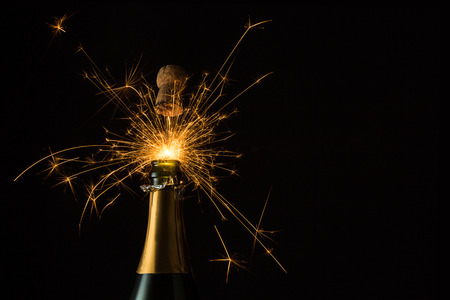 champagne pop: bottle of champagne with sparkler
