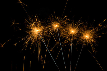 christmas profits: group of fireworks sparklers on black background