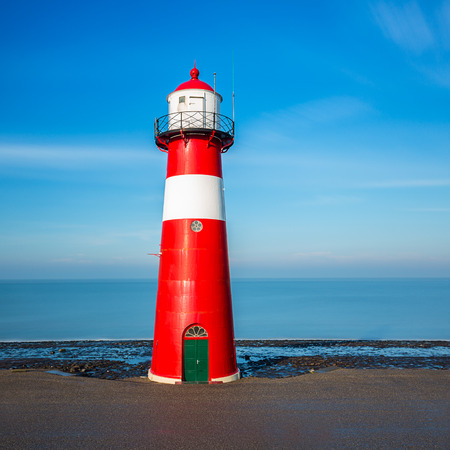 north holland: lighthouse near the sea in westkapelle in holland Stock Photo
