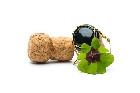 lucky clover: Lucky Clover on champagne corks on white background Stock Photo