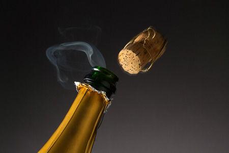 popping out: cork of champagne popping out of a bottle Stock Photo