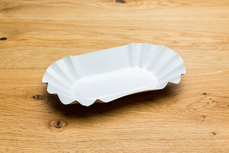 ries cup tableware on wood background photo