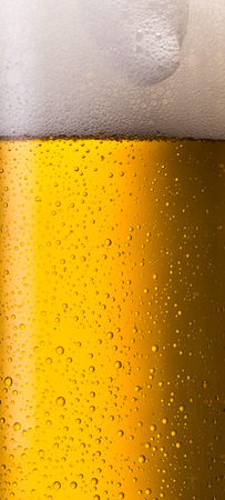 overflowing: overflowing german beer glass with dew drops Stock Photo