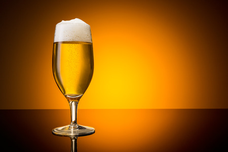 beer tulip: glass of beer with froth