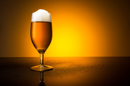 beer tulip: cold beer glass with drops of condensation Stock Photo
