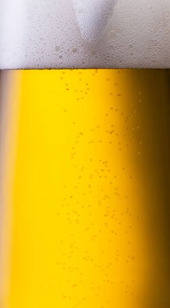 close-up from a fresh golden beer with dew drops Stock Photo