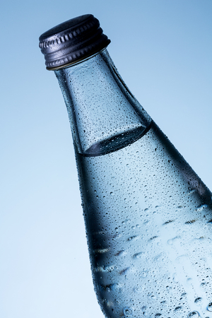 bottleneck: bottle of mineral water with drops of dew