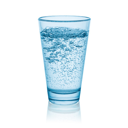 sparkling water in glass isolated on white background