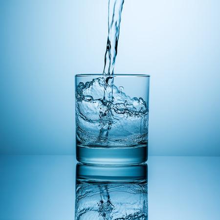 freshwater: glass of water with splashing water Stock Photo