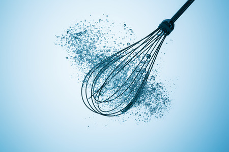 ooking: ooking whisk in water with air bubbles on blue gradient background Stock Photo