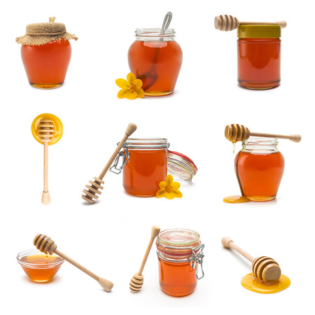 liquid gold: collection of different honey jars and honey dippers