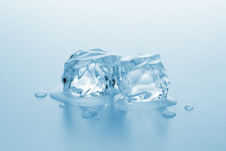 icecubes: Two ice cubes melting with drops of water