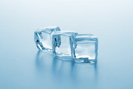 icecubes: Three clear ice cubes on gradient background