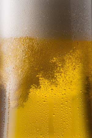 beer tulip: glass of cold golden beer with drops of condensation and froth Stock Photo