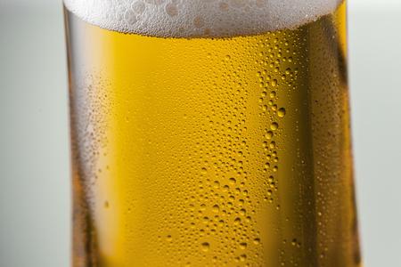 beer tulip: german beer in a glass with drops of dew
