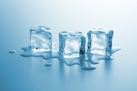 icecubes: group of three clear ice cubes melting with drops of water