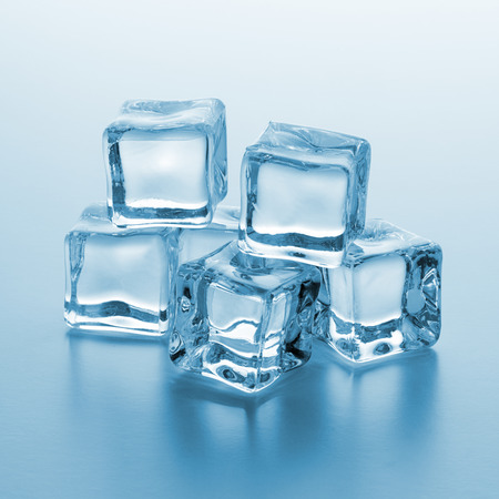 icecubes: Cold fresh ice cubes on blue gradient background Stock Photo