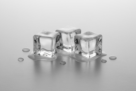 icecubes: roup of three ice cubes melting with water drops Stock Photo