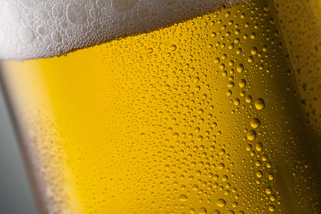condensation: german beer glass with froth and condensation drops of dew