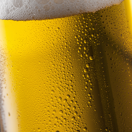 crone: glass of beer with drops of dew and foam crone Stock Photo
