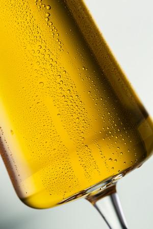 lass: lass of golden beer with down running dew drops