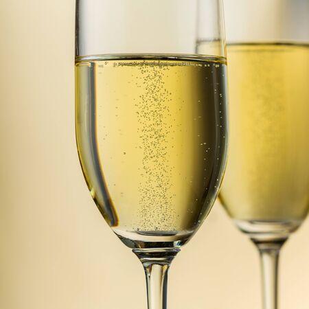 bubble acid: closeup of two golden champagne glasses