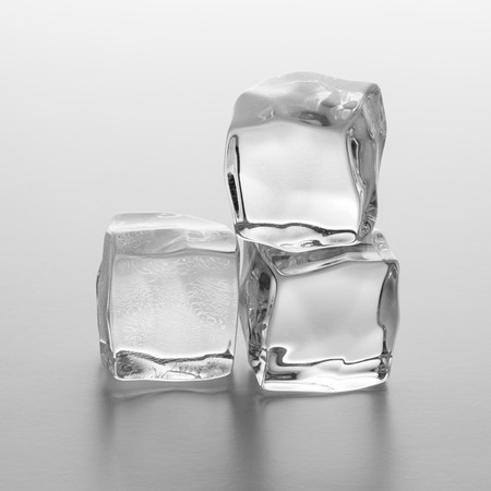 icecube: Three clear ice cubes on gradient background