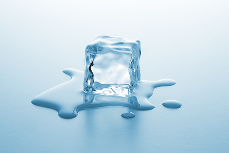 cold ice cube is melting with water drops Stockfoto