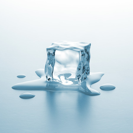 cube of ice lie in melting water