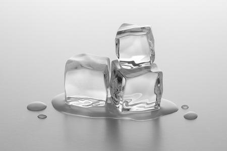 melting ice: pile of melting ice cubes on gray gradient background