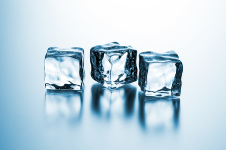 icecubes: group of ice cubes with reflection on gradient background