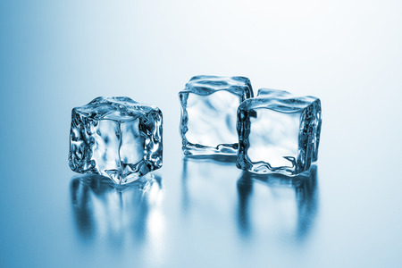 icecubes: group of three clear ice cubes on blue gradient background
