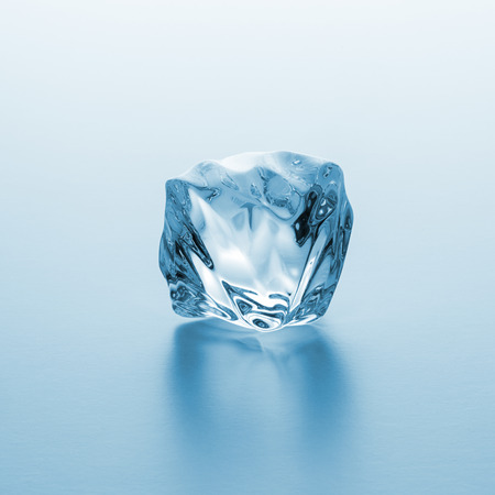 icecubes: clear ice cube on blue gradien background